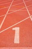 Pista numero uno di atletismo. Fotografie Stock Libere da Diritti