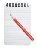 Pista y lápiz de nota fotografía de archivo libre de regalías