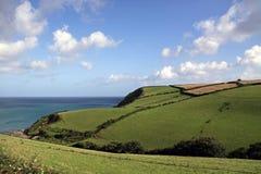 Pista y océano agrícolas verdes de granja Imagen de archivo libre de regalías