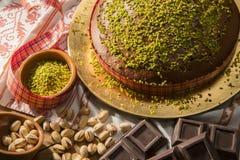 Pistacchi di cioccolato e di Al di Torta Fotografia Stock