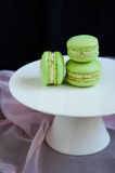 Pistacchio macaroons on cake stand Stock Photos