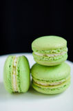 Pistacchio macaroons on cake stand Royalty Free Stock Image