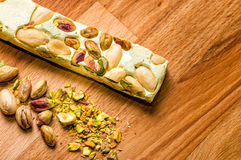 Pistache. A bar of pistachio and almond nougat called torrone, made in Italy Stock Photo