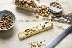 Pistache. Pistachio nougat bar and nuts Stock Images