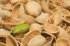 Pistachio 1. Close-up of a few shells and a pistachio Royalty Free Stock Photo