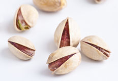 Pistachio. Group of pistachios on white background, making approach royalty free stock images