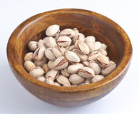 Pistachio. Group of pistachios in wooden bowl stock photo