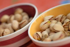 Pistachio. Into a bowl posed onto a table Royalty Free Stock Images
