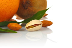 Pistachio and almonds with fruits Royalty Free Stock Images