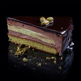 Pistachio biscuit with chocolate cream-mousse stock photography
