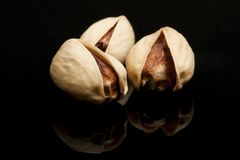 Pistachio on black background Stock Photos