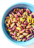 Pistachio in a blue bowl Royalty Free Stock Photo