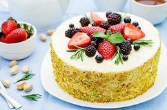 Pistachio cake with berry compote and rosemary mousse Royalty Free Stock Photo