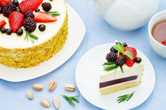 Pistachio cake with berry compote and rosemary mousse Stock Photos