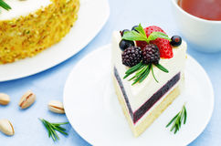 Pistachio cake with berry compote and rosemary mousse Royalty Free Stock Photography
