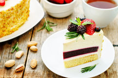 Pistachio cake with berry compote and rosemary mousse Stock Photography