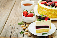 Pistachio cake with berry compote and rosemary mousse Stock Photo