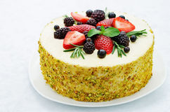 Pistachio cake with berry compote and rosemary mousse Stock Image