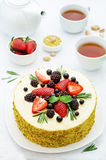 Pistachio cake with berry compote and rosemary mousse Stock Images