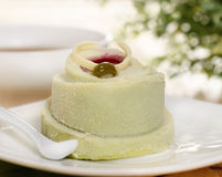 Pistachio cake decorated with a raspberry jam Stock Photography
