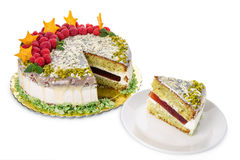 Pistachio cake drizzled with white chocolate. Stock Photos