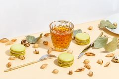 Pistachio cake makaroons and pistachios on a beige background. Top view royalty free stock photos