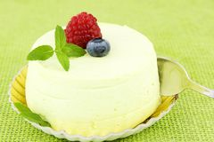 Pistachio cake with red fruits Royalty Free Stock Photo