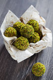 Pistachio candy. Homemade candy of dried fruits, chocolate and pistachio, selective focus Royalty Free Stock Photography