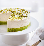 Pistachio cheesecake, mousse cake on a white plate Stock Photos