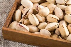 Pistachio close up in a wooden box Stock Photos