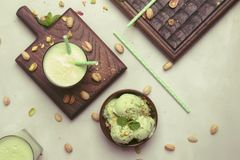 Pistachio cocktail with milk and mint, gray kitchen table, copy space, top view. Pistachio cocktail with milk and mint, gray kitchen table, copy space, top  view stock images