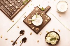Pistachio cocktail with milk and mint, gray kitchen table, copy space, top view. Pistachio cocktail with milk and mint, gray kitchen table, copy space, top  view stock photography
