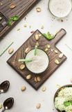Pistachio cocktail with milk and mint, gray kitchen table, copy space, top view. Pistachio cocktail with milk and mint, gray kitchen table, copy space, top  view stock photos