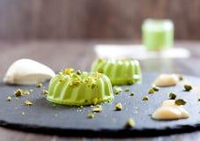 Pistachio and condensed milk panna cotta dessert Royalty Free Stock Images