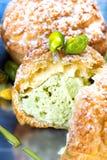 Pistachio dessert with Pistachios Cream. Profiteroles with Pista Royalty Free Stock Images