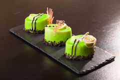 Pistachio dessert on plate Stock Image