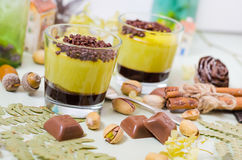Pistachio dessert served with chocolate and fern leaves Royalty Free Stock Photo