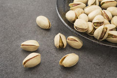 Pistachio on dish Stock Photography