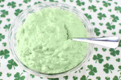 Pistachio Fluff. A bowl of pistachio fluff with a shamrock background for Saint Patrick`s Day dessert Royalty Free Stock Images