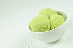 Pistachio Ice Cream in a Bowl Stock Images