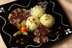 Pistachio ice cream with chocolate cookies Stock Photos