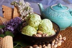 Pistachio ice cream closeup  nuts, lilacs, still life, beautiful Stock Photo
