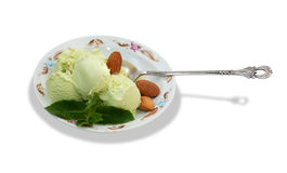 Pistachio ice cream with mint leaves isolated Royalty Free Stock Photos
