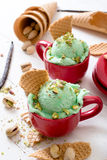 Pistachio ice crema. Pistachio flavor ice cream in the cups.Selective focus on the front ice cream Royalty Free Stock Photography