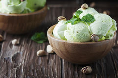 Pistachio icecream with mint and nuts Royalty Free Stock Photo