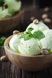 Pistachio icecream with mint and nuts Royalty Free Stock Image