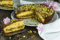 Pistachio and lemon drizzle cake. On rustic wooden table Royalty Free Stock Photos