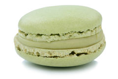 Pistachio macaron macaroon cookie dessert from France isolated. On a white background stock photos
