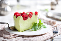 Pistachio mousse cake, cheesecake with raspberry Royalty Free Stock Photos