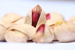 PISTACHIO NUT. Piece by piece pistachio. A lot of pistachio. Film grain visible Royalty Free Stock Photo